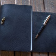 Open view of a black journal by Trekker Leather Co
