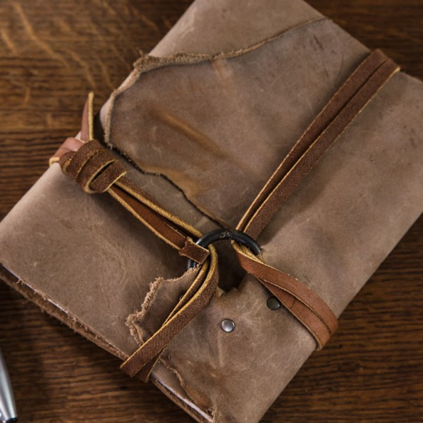 The Brass Ring Leather Journal is made by Trekker Leather Co