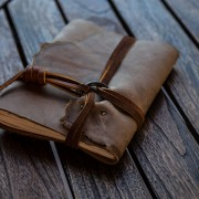 Leather journal with a brass ring riveted to it