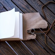 A photo of our leather journal with brass ring open
