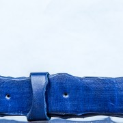 This blue leather belt has been hand-cut and dyed multiple times for a rustic, high-end look.