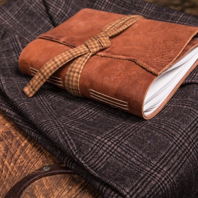 The tan leather journal with plaid lace from Trekker Leather Co