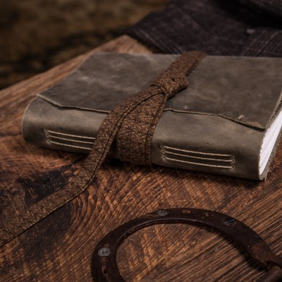 This is a green leather journal from Trekker Leather Co, notice the plaid lace