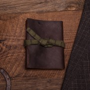 This is a journal made out of Brazilian Kodiak Leather, bamboo stitching, and a plaid lace.