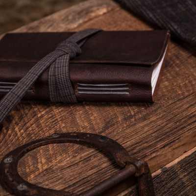 Kodiak leather journal with a grey tweed lace