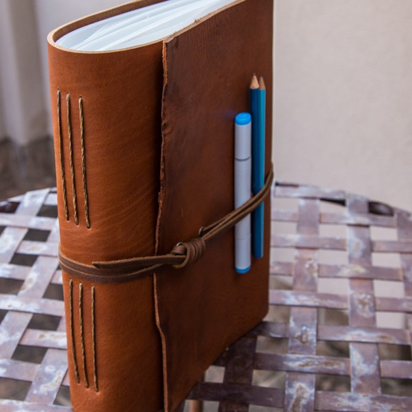 "The Tan leather Sketchbook by Trekker Leather Co is 9"" x 12"" and uses some of the thickest leather you can find."