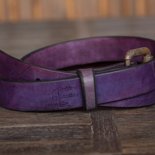 The Purple Leather Belt by Trekker Leather Co coiled by itself