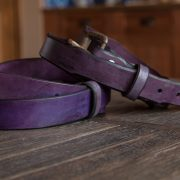 Purple leather belts stacked on top of each other