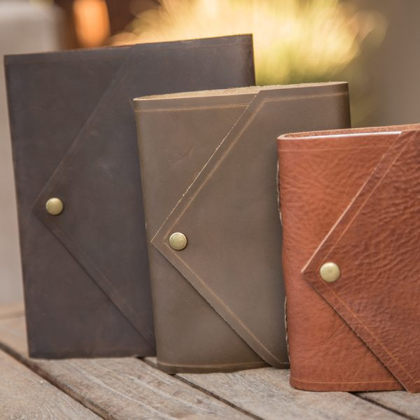 Envelope-style leather journals by Trekker Leather Co.