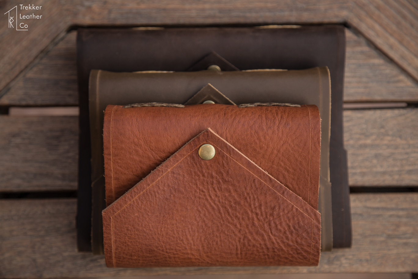 Stacked leather journals with an envelope style by Trekker Leather